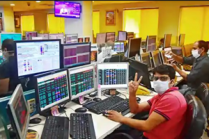 Dalal Street Traders showing victory sign