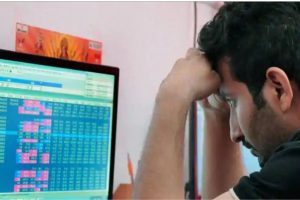 NSE NIfty trader in front of screen
